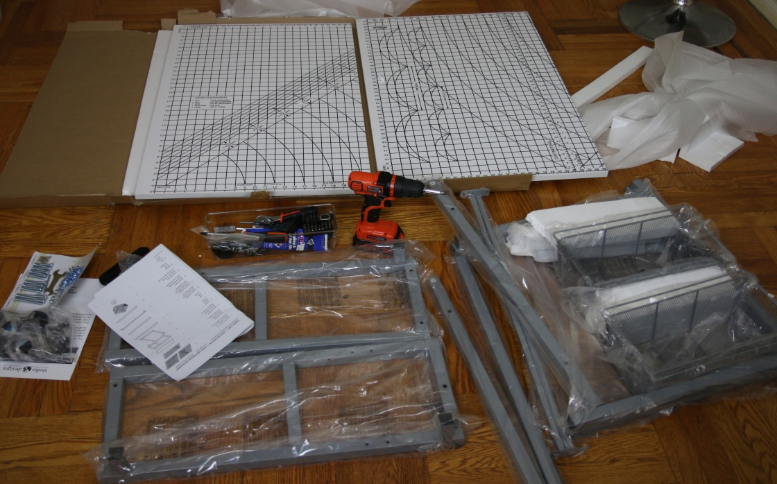 A picture of the Studio Designs cutting table parts and tools.